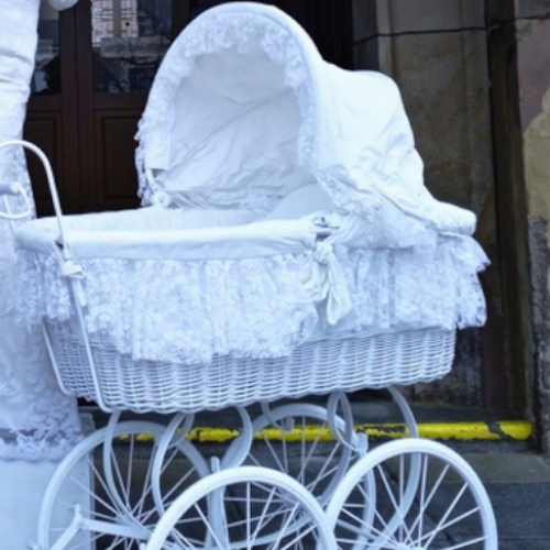 White lady with a historic pram